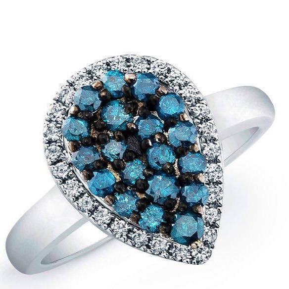 Blue Diamonds in beautiful ring. One of a kind design.