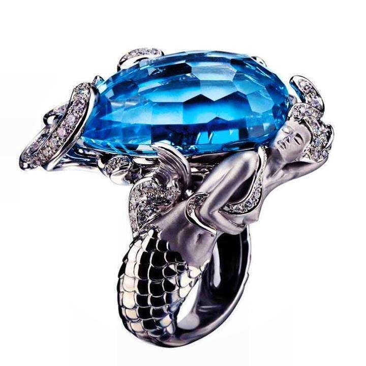 White and large blue - diamonds ring.